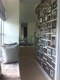 Collection of family photos on wall