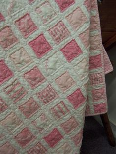 Super easy!  You simply place your little squares on top of another piece of fabric + batting + backing, and you sew down the edges.  Throw it in the wash and poof!  There you have it.  This is a good one for all you wanna be quilters.  No piecing involved! Vintage Baby Quilt