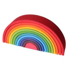 Large Wooden Rainbow Tunnel from Grimms Spiel & Holz of Germany is a wooden stacking and nesting toy. 12 colorful arcs will inspire hours of creative open-ended play!