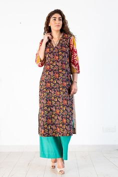 An interesting floral & geometric block print  Kurta  with elegant collar and tuck details which accentuates the classic look !  Use of multiple color blocks speaks of the fine craft of hand block prints in Bagru .The technique is intricate and labor intensive which requires fine skill of the block printer.  Very fine tucks at the sleeve edge  & hand finished  details add to the elegance.  Team it up with aqua ,military green or deep red   Farshi pants to create an urban Chic look…
