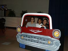 1950's wooden car silouette painted and used as a photo booth