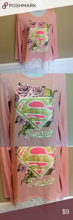 """Supergirl Pink with Lace Shirt Maker: Supergirl  ♥ Material: No Tag with Info, but I believe a cotton blend ♥ Color: Pink ♥ Measured Size: Pit to pit- 16"""" Pit to cuff- 16"""" Shoulder to waist- 26""""  ♥ Tag Size:  No tag ♥ Actual Size: Small based on Measurements PLEASE CHECK YOUR ACTUAL MEASUREMENTS TO MAKE SURE IT IS THE RIGHT SIZE! THANKS! ♥ Condition: Great Like New Used condition ♥ Item #: (office use only) C  INSTAGRAM-thehausofvintage1984 Facebook- intergalactic haus of vintage 1984 or…"""