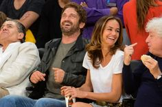 """This appears to be a Gerard Butler Jesuit clone with his Jesuit girlfriend. Notice his shallow laugh, and adolescent maturity - typical of clones, who are actually all under a year old and have been """"matured"""" with accelerated growth hormones into """"adulthood"""". Though Jesuits can clone a person, it's not possible to give them the emotional maturity of the person they impersonate."""