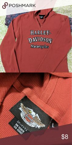 Harley Davidson hooded shirt Harley Davidson orange hooded top in excellent condition. Perfect for those cool spring rides, paired with your skinny jeans and boots. Harley-Davidson Tops Sweatshirts & Hoodies