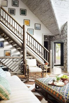 A white washed cabin with a crisp palette, worn finishes, and vintage tribal rugs