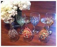 Enamel paint, Q-tip, cold oven. Bake and let cool in oven. Easy-peasy. painted glasses