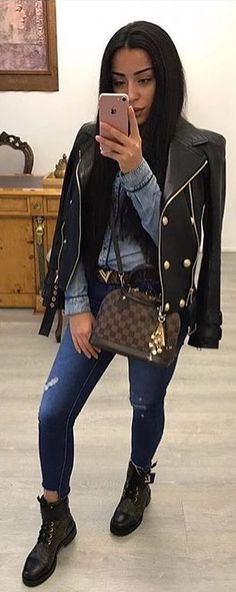 #spring #outfits woman with black leather zip-up jacket, gray long-sleeved shirt, and distressed blue denim jeans. Pic by @fashionloovy