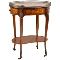 Marble-Top Oval Side Table | From a unique collection of antique and modern Side Tables at https://www.1stdibs.com/furniture/tables/side-tables/.