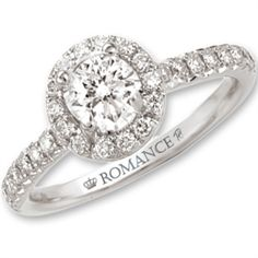 """ROMANCE"" Engagement Ring This 14 karat white gold Diamond Engagement Ring is a timeless beauty which she will cherish forever and ever. A large enigmatic 1/3 Ct prong set round cut center stone diamond is adorned with 32 Sparkling round cut diamonds that bounds the center and flow down the shank . All the Diamonds are beautifully pave & bezel set in luminous 14 karat white gold. Our ""Romance"" collection in 14kt ""Forever"" White Gold .53pt TW with .25ct Center Round Brilliant Diamond $1999"