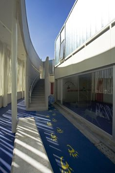 Image 17 of 17 from gallery of El Porvenir Social Kindergarden / Giancarlo Mazzanti. Giancarlo Mazzanti, Kindergarten Pictures, Modular Structure, Interior Architecture, Fair Grounds, Stairs, Gallery, Travel, Kindergartens