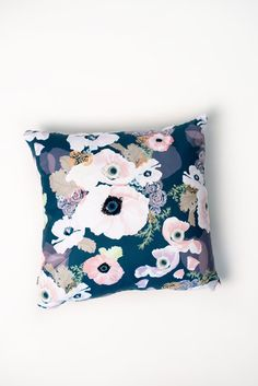 Get our gorgeous and ever popular Une Femme print in your home with our plush and decorative pillow featuring a navy and blush pink color