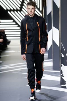 Fall 2014 Menswear / Y-3 / Evidently Yohji Yamamoto had superheroes in mind, and, none too subtly, he put himself forward as their tailor. But the shoe fit (this being the baby of Adidas, more often than not it was a sneaker). Menswear designers are forever discussing the fusion of performance and style, of sportswear and tailored clothing: Y-3 more or less wrote the book. It flew into Paris to remind the world of that fact. It didn't have to get help: It is help.