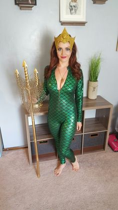 Mera queen of atlantis from the aquaman comics. She is a DC bombshell. Mera cosplay. Crown made from cardboard glued to a tiara  and spray painted gold.