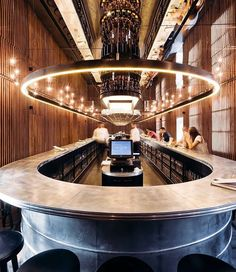 polish firm @projektpraga has designed the 'perłowa beerhouse' with a single 30-meter long counter bar dominating the space,…