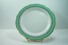 Ancient plate Manufrance earthenware green border with golden frieze and edge…