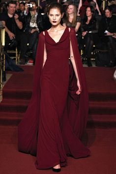Zac Posen Fall 2013. Cape dress... I want to walk around making big dramatic arm movements in this, hehe.