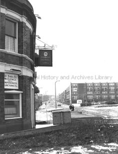 Black and white photograph showing the Bridge Hotel and blocks of flats in Liverpool Road, St. MCL - Clare Collection 3 - Black and white photographs and drawings of St. St Helens Town, Saint Helens, Archive Library, My Town, Working Class, Photographs, Photos, Driftwood, Duke