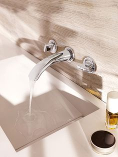 This Ondus 3-hole basin mixer is wall-mounted to free up space around the bowl, Grohe