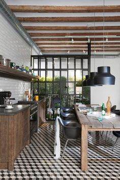 Black and white geometric floor - Raw wood kitchen cabinets - White subway backsplash on entire wall - Exposed wood ceiling beams - Contemporary steel framed multi-paned windows - Sta Caterina Home - Living by the Market
