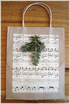 re-purpose paper bags AND  old sheet music  into a  . Gift Bag.. click to see instructions.>>>