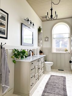 Farmhouse Bathroom update - after Laundry Room Bathroom, Bathroom Floor Tiles, White Bathroom, Master Bathroom, Farmhouse Mirrors, Farmhouse Chandelier, Farmhouse Bathrooms, How To Patch Drywall, Old School House