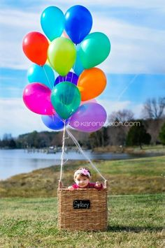 I have a basket that will work, if you get some helium balloons! could be cute!