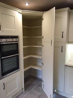 Brilliant kitchen storage idea... Walk in corner pantry?
