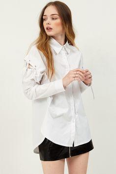 Jin Shoulder Eyelet Shirt . Discover the latest 2017 #fashion trends online at storets.com today.  #whiteshirt #shouldereyelet #eyeletshirt