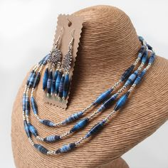 Magazine paper bead necklace and earring set by FroggedCrafts, £25.50