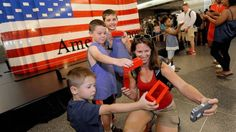 """PHOTO: The Colvin family, from left, Adrian, 4, Riley, 7, Jack, 10, and mother Shawna, of Tiffin, Iowa, take a """"selfie"""" after helping build the worlds largest LEGO American flag."""