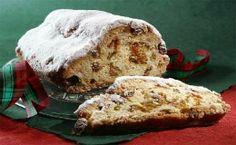 Receita de stollen, o bolo de Natal alemão em formato de pão com frutas secas e coberto de açúcar.