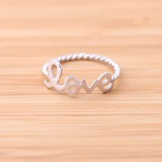 pure,   love ring with twisted ringline