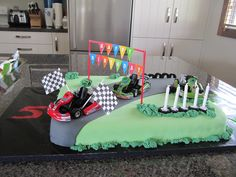 My grandson wanted a go-kart birthday cake so here it is.  Got the toys from America because I couldn't find any here!  The look on his face was well worth the effort.  I had to paint two of them green to match his fathers and Johnnies carts.  Was easy to do