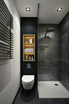 Illuminated light wood shelving completely changes the look in this stylish small bathroom.