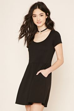 A French terry knit fit-and-flare dress with short sleeves, slanted front pockets, and a scoop neckline.