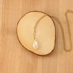 Pearl chalcedony pendant necklace. Gold plate over brass chain, measuring 26″. Handmade in Portland, Oregon.