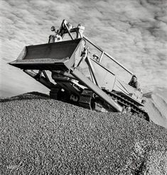 """November 1942. """"Columbia Steel Company at Geneva, Utah. Bulldozer handling gravel for concrete during the construction of a new steel mill which will make important additions to the vast amount of steel needed for the war effort."""" Photo by Andreas Feininger for the Office of War Information."""
