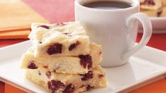 Enjoy these homemade cranberry shortbread bars with orange flavor - perfect for dessert.