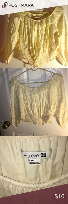 Never Worn, Off the Shoulder, Cropped Blouse Never Worn. Forever 21. Cream Cropped Blouse. Meant to be worn off the shoulders but can be worn on shoulders. Lace around collar. Scrunched ban around bottom. Loose quarter length sleeves. This Blouse reminds me of a Flower Child or Cute Pirate. Forever 21 Tops Crop Tops