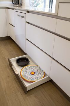 Kickboard Drawers Provide The Perfect Storage For Platters And Baking  Trays. Small, Modern Kitchen