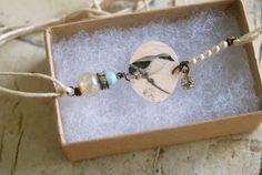 Hello birdy.vintage beaded, bird charm,string bracelet Tiedupmemories