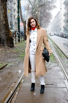 """Ece Sukhan, editor    """"I'm wearing a Umit Benan coat and jacket with Levi's jeans, Chanel boots and a Trussardi bag."""""""