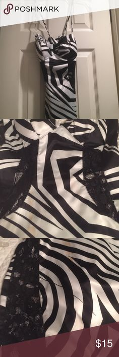 Sexiest dress you will own Lace sides and torso see through black and white spaghetti straps, worn once, look at 4th photo some wine stain should come out with dry clean rubber ducky Dresses Prom