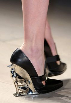 I'd just want to display these shoes; I wouldn't want to walk on something so cute.  These shoes are  the David Koma Fall 2012 greyhound heels.