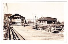 Photo postcard of the second Sidney-Anacortes ferry landing, at the foot of Beacon Avenue circa 1947. Canada Customs building is to the right.