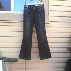 "Dark Wash DKNY Jeans 99% cotton, 2% spandex flares. Distressed, pocket detailing front & back. Measured flat 30"" inseam 13"" across waist band. DKNY Jeans Flare & Wide Leg"