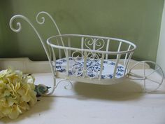 Check out this item in my Etsy shop https://www.etsy.com/listing/154649021/white-metal-blue-white-tile-wheelbarrow