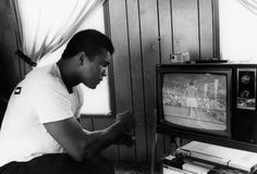 """Ali at his training camp in Pennsylvania, 1978  -  Dr. Harry Edwards:  """"As a 1960s sports activist, I stood in profound awe and admiration of Muhammad Ali as he steadfastly risked everything in deference to his religious beliefs and political convictions. For me and millions around the world, his courage and commitment elevated him from the greatest boxer of his era to a transcendent and enduring cultural hero and icon whose life and contributions helped define the character of a generation both within and beyond the sports arena. It has been an honor and a privilege to know him.""""  -  Dr. Harry Edwards is a sociologist whose work focuses on the experiences of African-American athletes. He is a professor emeritus at the University of California, Berkeley."""
