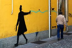 His face is a mystery, but Kenny Random (aka Andrea Coppo) is a famous Italian street artist from Padova. He used to work during the night, hidden in the d Installation Street Art, Italian Street, Italian Artist, Street Artists, Public Art, The Darkest, Graphic Art, Mystery, Silhouette