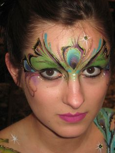 Face painting in a peacock design.